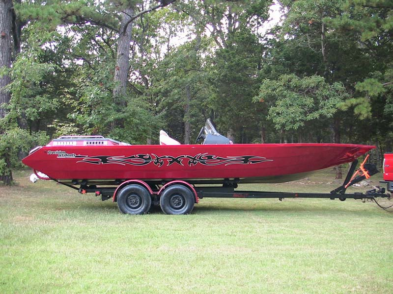 precision boats red boat on trailer