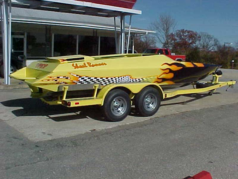 yellow shoal runner boat on a trailer