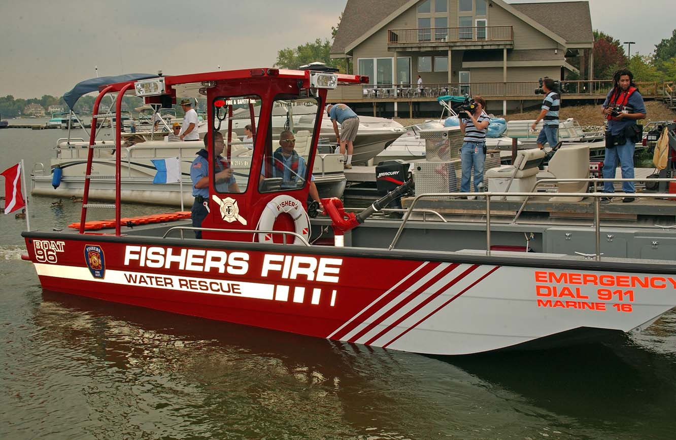 Fishers fire water rescue boat docked with other boats around
