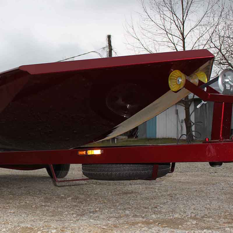 red boat on a trailer