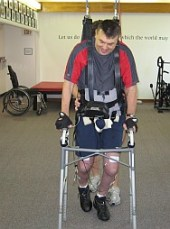 Walking with Sci-Step Electro stim withGait support