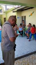 Francisco praying the salvation prayer with expected mothers at a maturnity home in San Marcos Ocotepeque Honduras