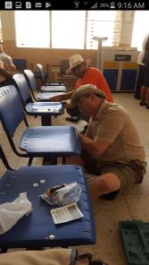 Repairing chairs at the La Libertad Hospital