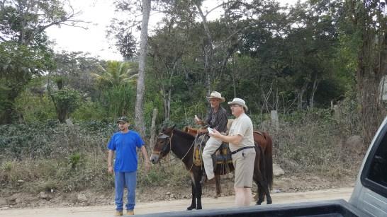 Praying salvation prayer with cowboy