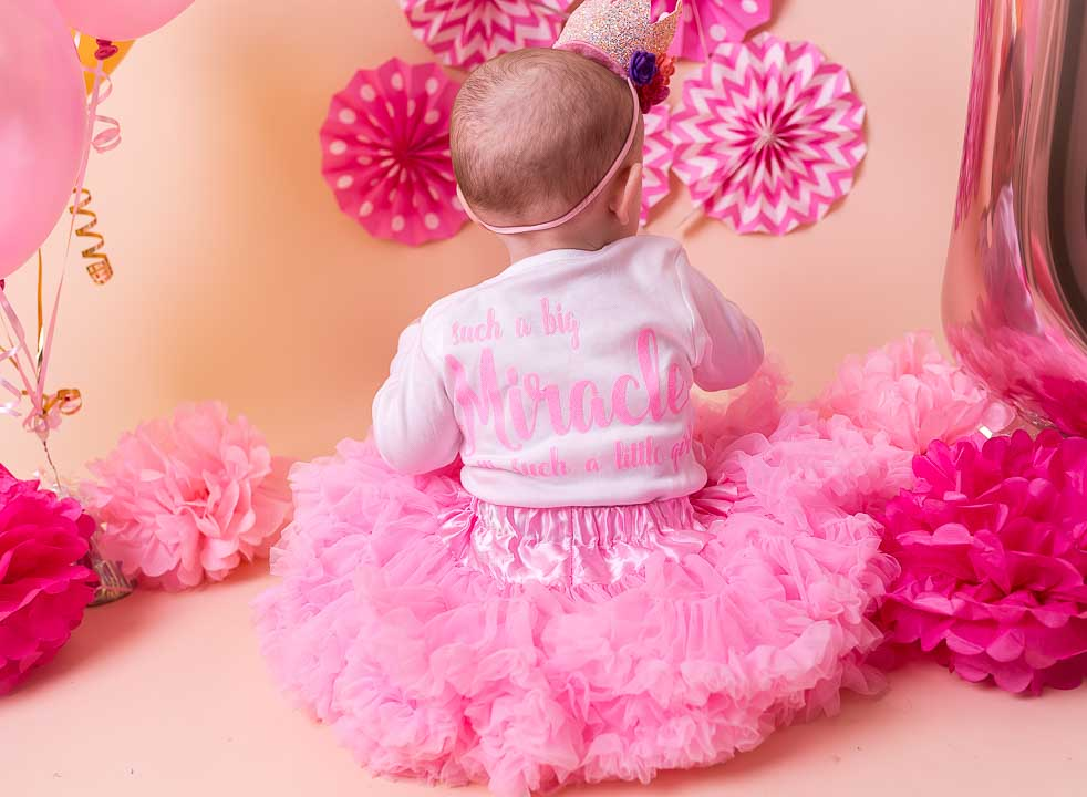miracle baby -Cake smash 1st Birthday Photos - balloons and baby girl and decorations, the whole set up