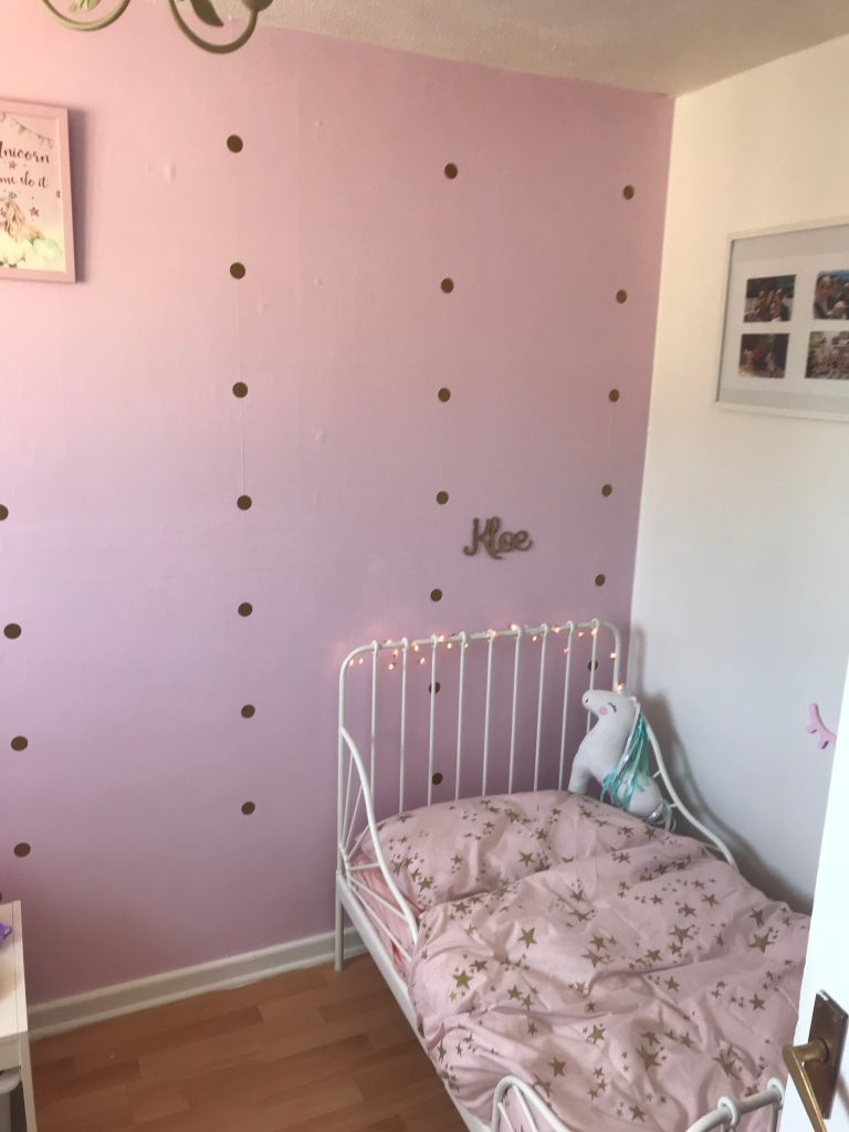 pink toddler girls bedroom pink wall gold spots white ikea extendable bed with pink bedding unicorn photos