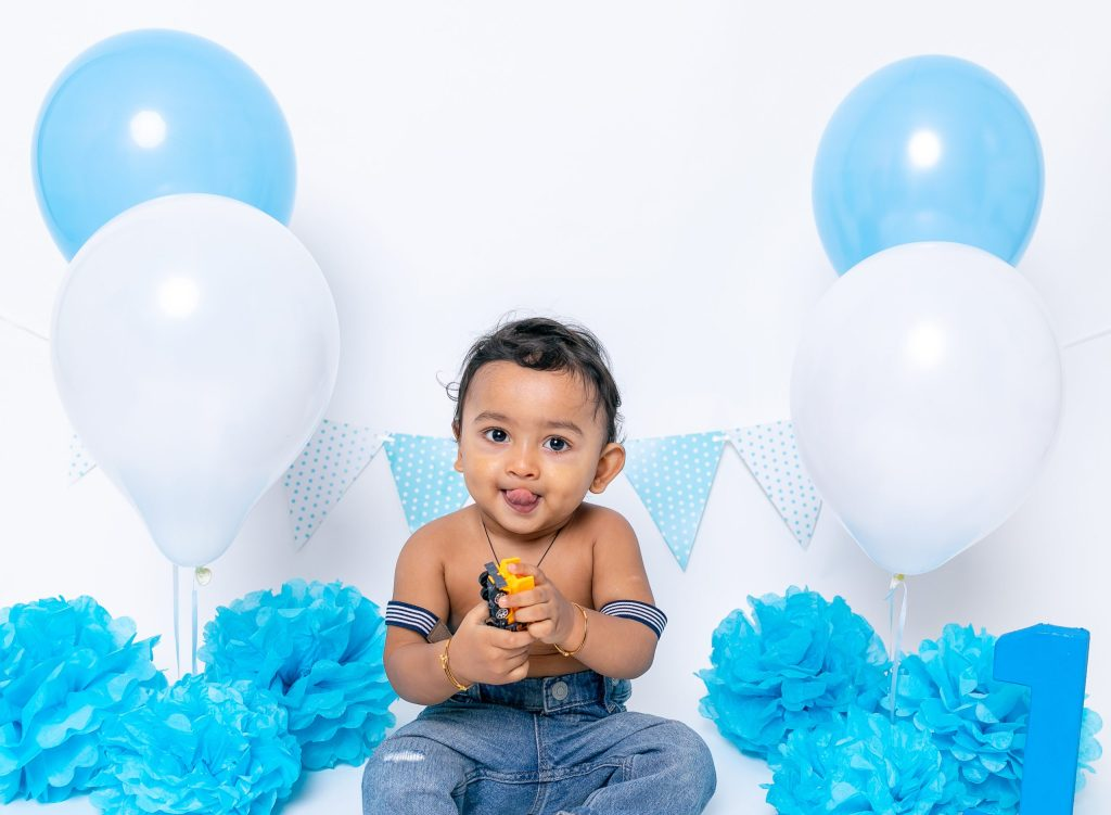 Celebrating 1st Birthday is very important have fun with Cake Smash Photoshoot North London Studio Enfield Photographer