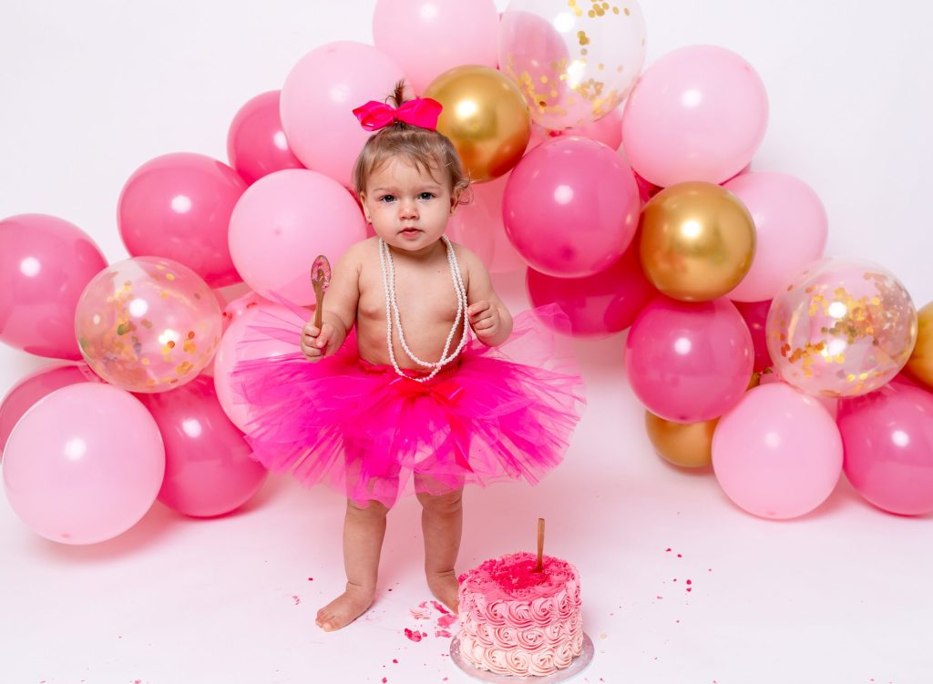 Cake Smash Photography, Girl Daughter Baby having Birthday Celebration Cake Smash 1st Birthday in London Enfield Barnet