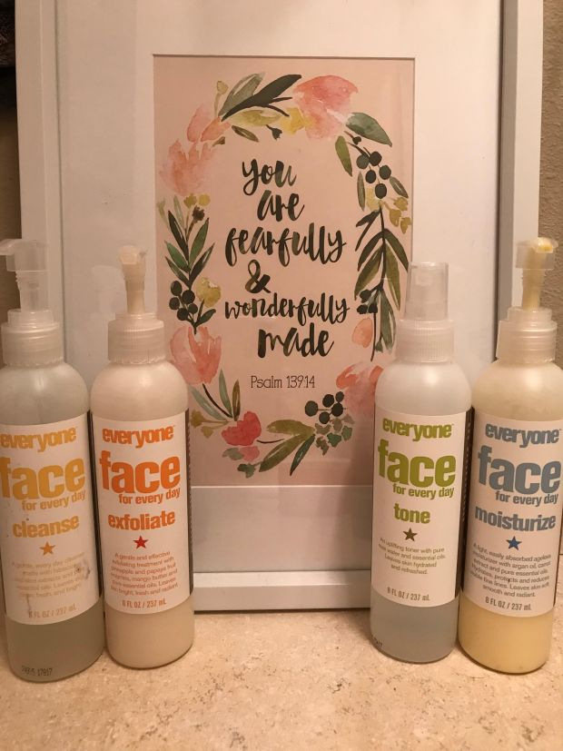 everyone face products in front of scripture picture