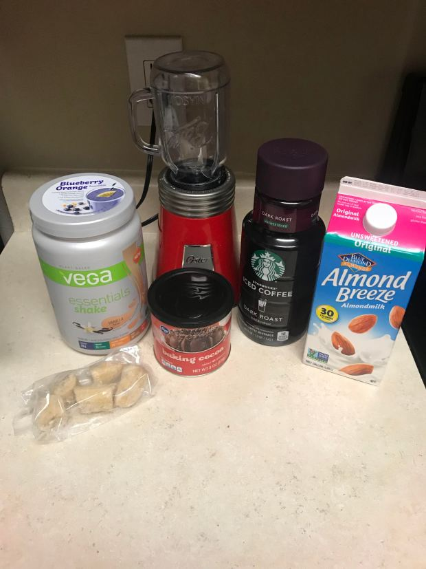 protein powder, blender, coffee, cocoa powder, almond milk, banana