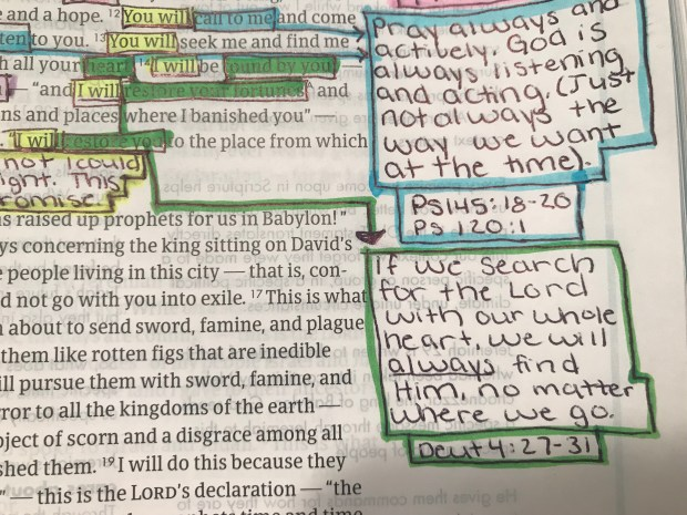 Bible page with highlighting and notes
