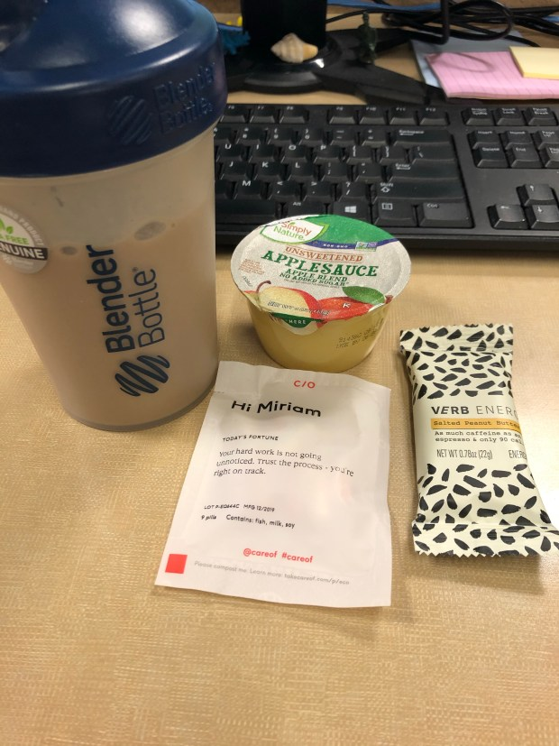 Protein shake, applesauce, verb bar, and vitamins for breakfast