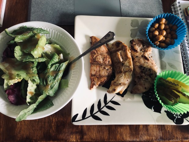 Salad, grilled chicken, chickpeas, and pickles