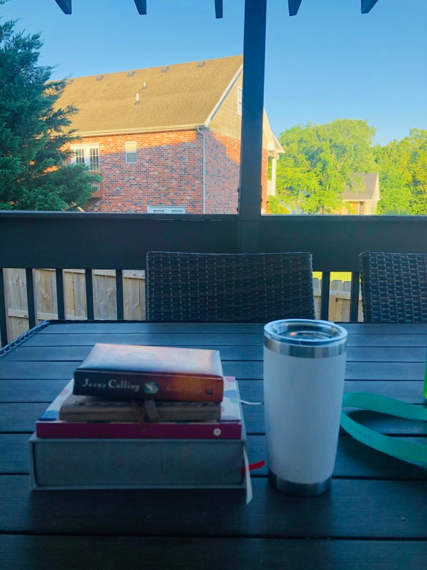 Iced coffee, devotional, bible, and journals