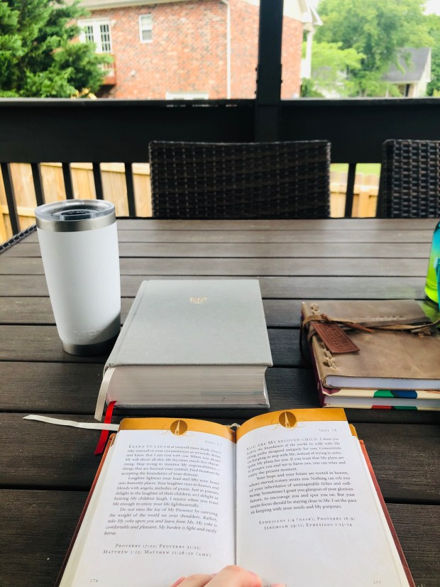 Iced coffee, journal, bible, and devotional