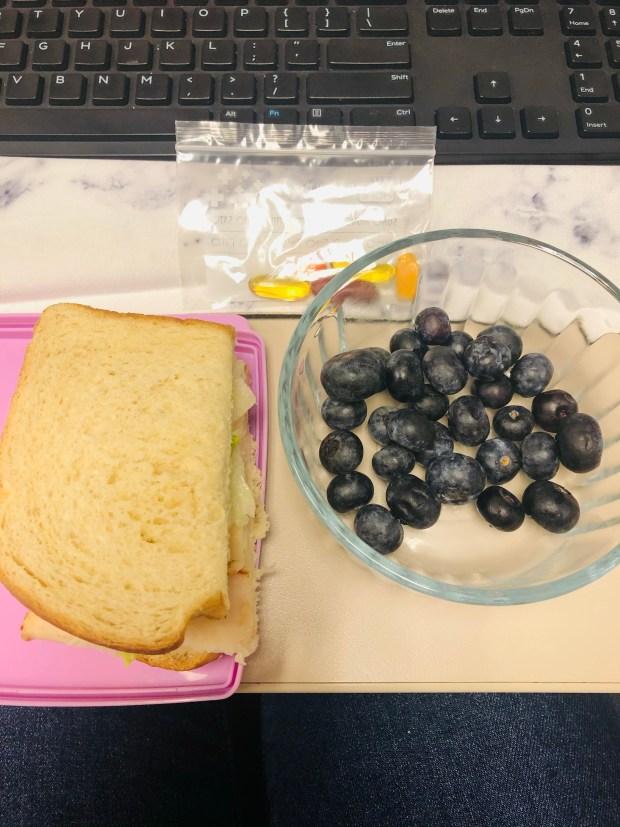 Sandwich, blueberries, and vitamins