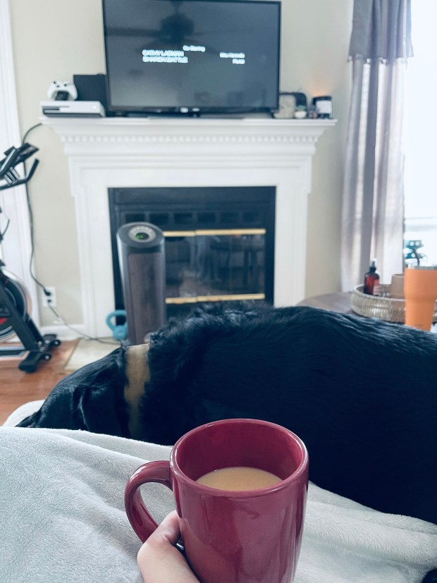 Drinking coffee in the morning in cozy living room