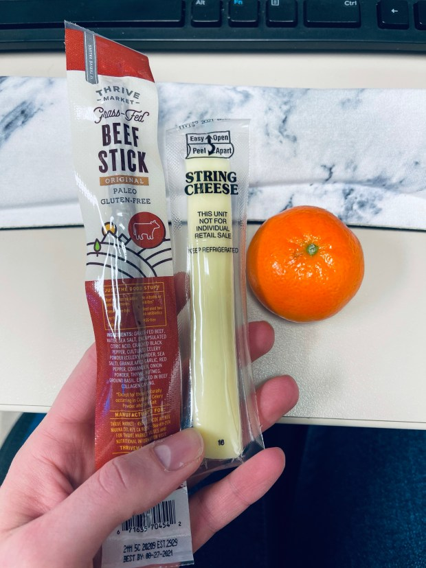 Beef stick, cheese stick, and orange