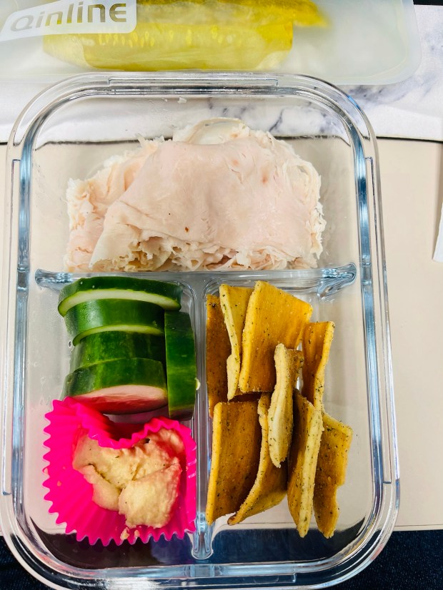 Pickles, turkey slices, cucumbers, and pita chips for lunch at work