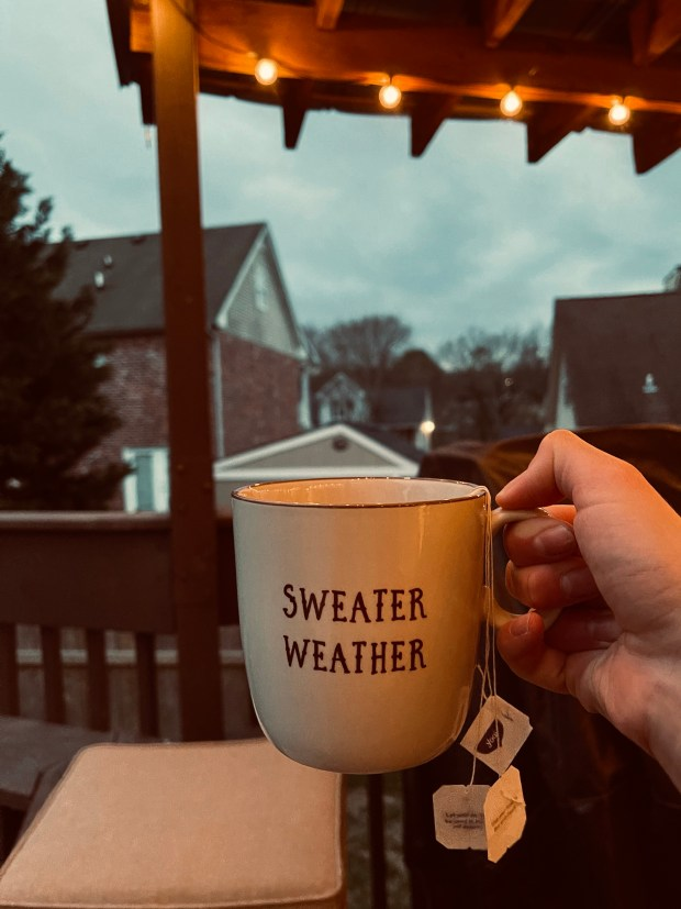 Drinking tea on porch with lights