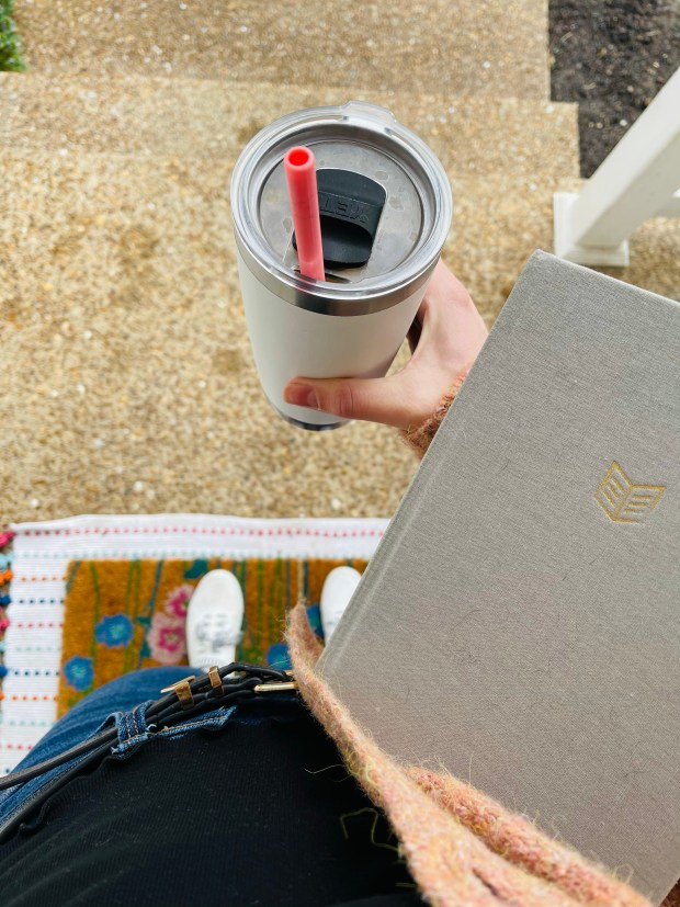 Bible, coffee, and church outfit on porch