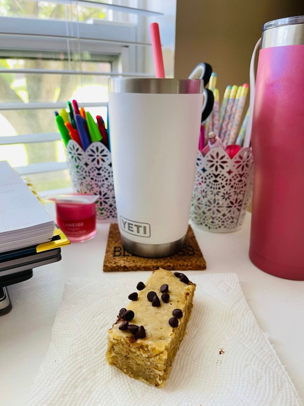 banana bread and iced coffee at desk