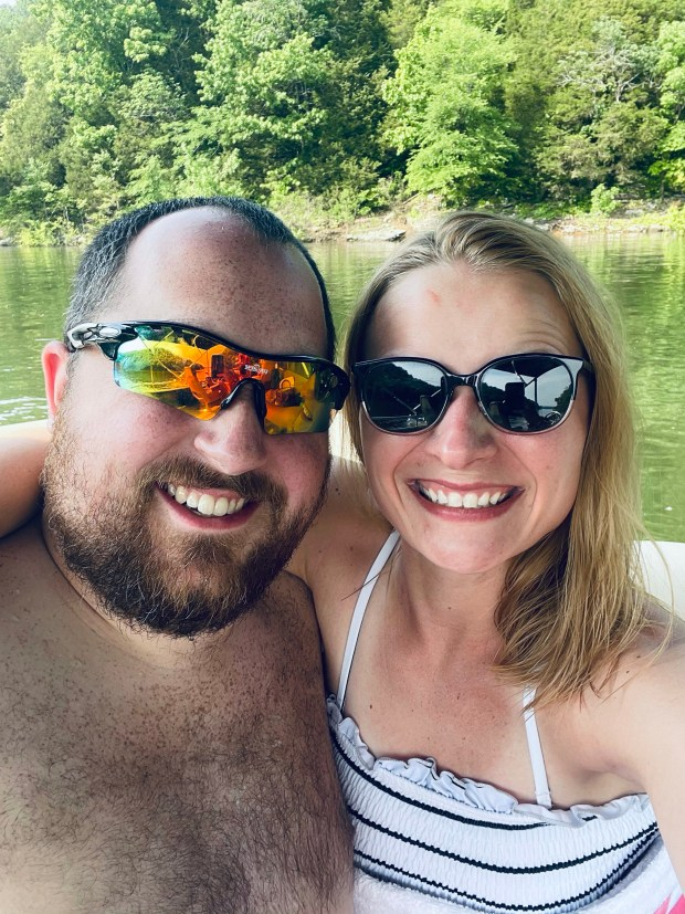 lake day photo in swimsuits and sunglasses on boat