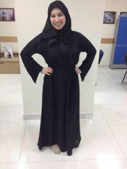 Me in my very own abaya - the traditional dress for women. I designed it myself!
