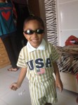 In the USA outfit that I brought him. And upside down sunglasses