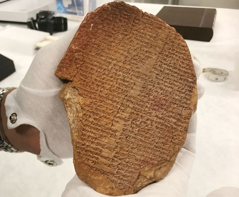 A clay tablet with cuneiform writing: the Epic of Gilgamesh
