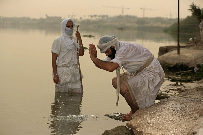 Mandaeans perform a morning ritual from the Ginza Rba