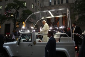 Pope Francis rides by crowds outside of St. Patrick's Cathedral in New York. Credit: Damon Winter/The New York Times/Pool/Reuters