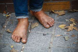 Many Syrian children are working, and thus not attending school, in order to help provide for their families https://commons.wikimedia.org/wiki/File:Syrian_Refugee_without_shoes,_Istanbul,_Turkey.jpg