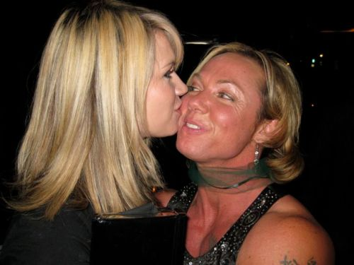 Weekly Photo Challenge: Kiss... Mom getting a birthday kiss from her daughter