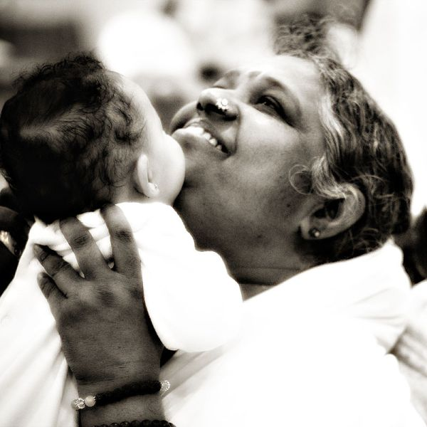 Musings: Can A Hug Make You Happy? Amma giving a baby a motherly hug