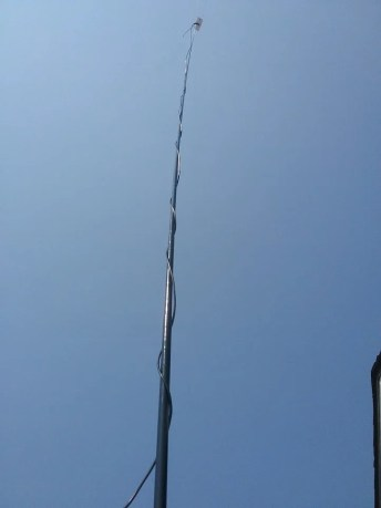 I wound the RG58 up the antenna, but it can be zip tied too.