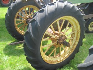 Spoked wheels, a rather expensive option back in the day, offered light weight compared to their cast iron equivalents.
