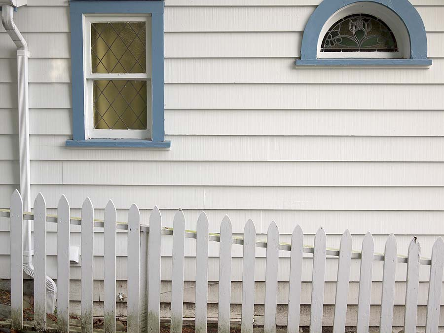 White picket fence in the lane north of 27th Avenue at Dunkirk Street.