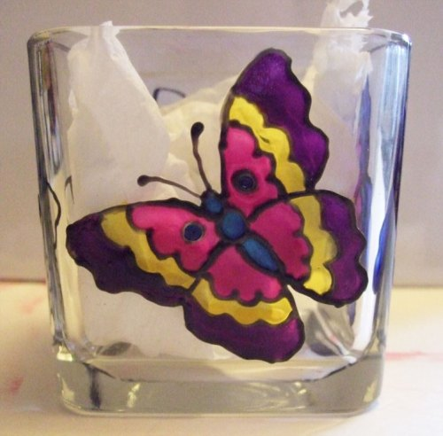 Completed painting the butterfly to create a stain glass effect using Pebeo Vitrea 160 paint.