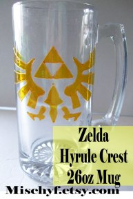 Stain glass painted Zelda Hyrule Crest 26oz mug. Found only at mischyf.etsy.com
