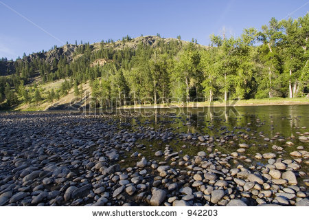 stock-photo-riverbed-with-pebbles-in-the-evening-sun-kettle-river-british-columbia-canada-adobe-rgb-942203