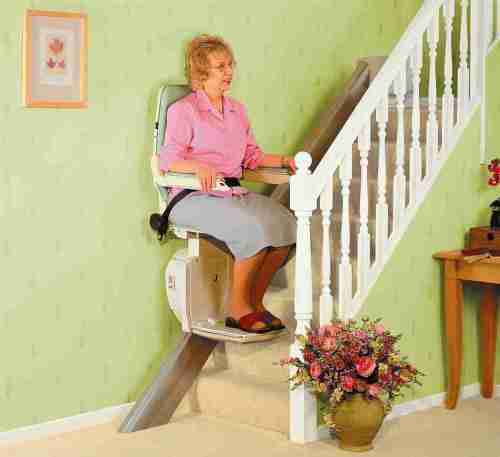 Lady on straight stairlift
