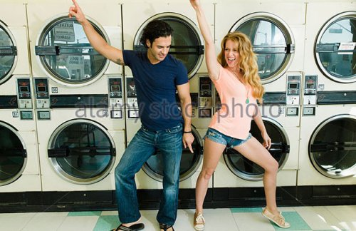 a-beautiful-lady-dances-with-a-smart-young-man-in-san-diego-coin-laundromat-dfnck2.jpg