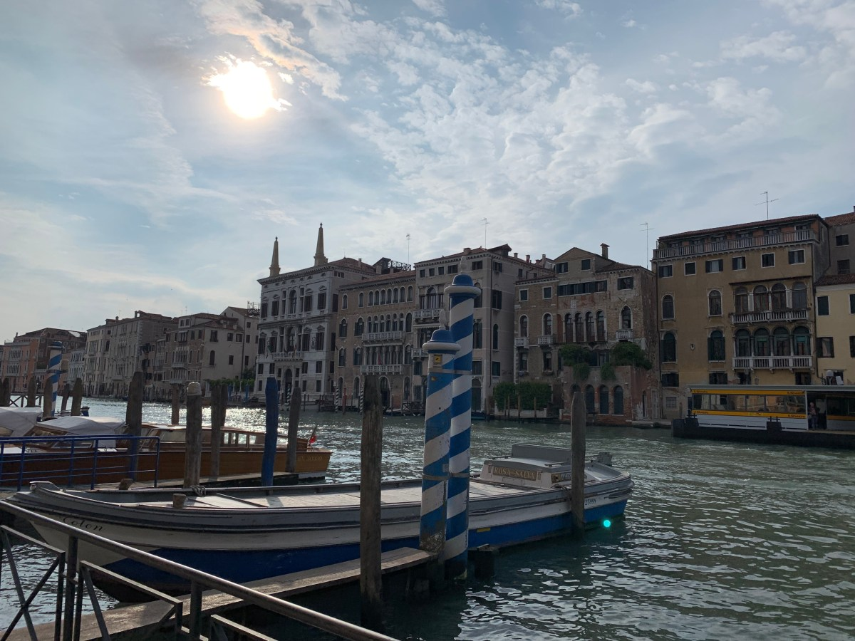 Venice photo of waterway with sun breaking through the clouds