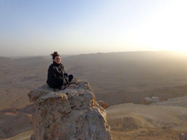 Sitting on Har Gamal at sunset in Mitzpe Ramon, Israel