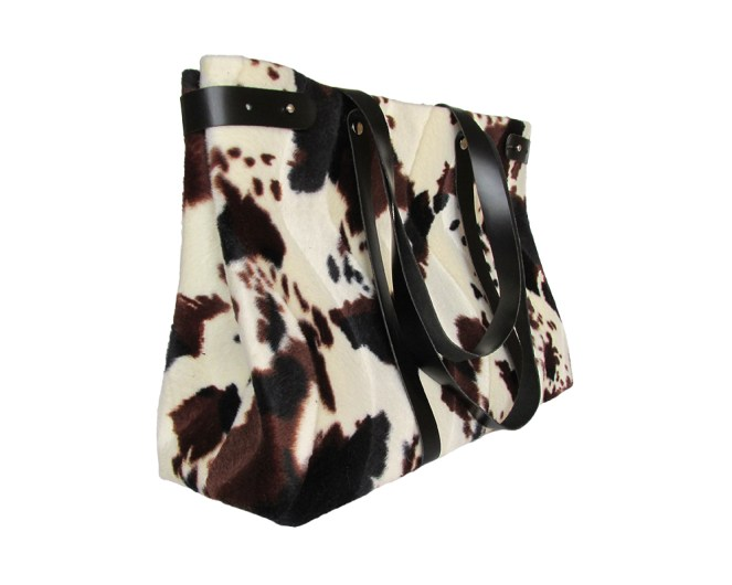 Faux cow fur fabric tote bag with black leather straps and black satin lining. Four internal pockets. by misp https://www.etsy.com/listing/206042387/