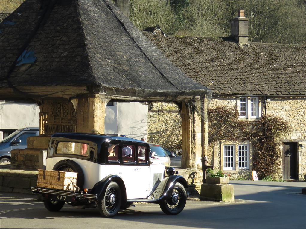Market Cross and vintage car in Castle Combe Wiltshire
