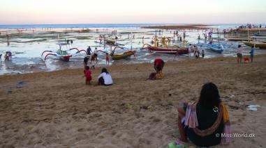 Lowtide - Balinese people gathering in the sunset, Sanur Beach Bali