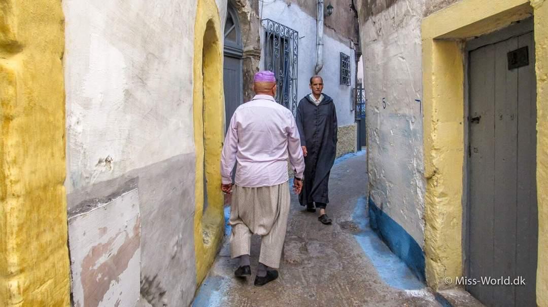 Moroccan men in a narrow alley in the medina of Essaouira Morocco