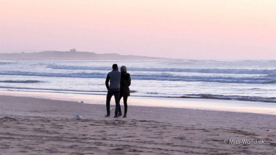 Romantic holiday in Morocco - Couple on the beach at sunset